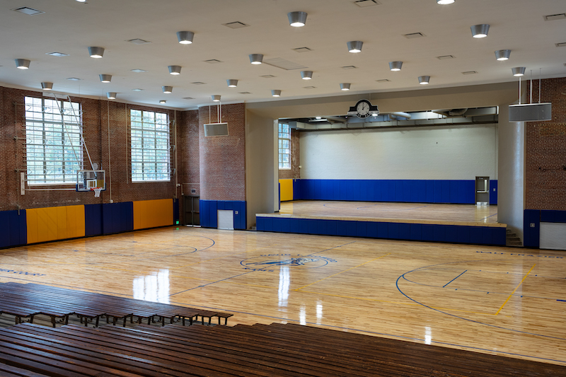 David T. Howard School gymnasium and stage after rehabilitation
