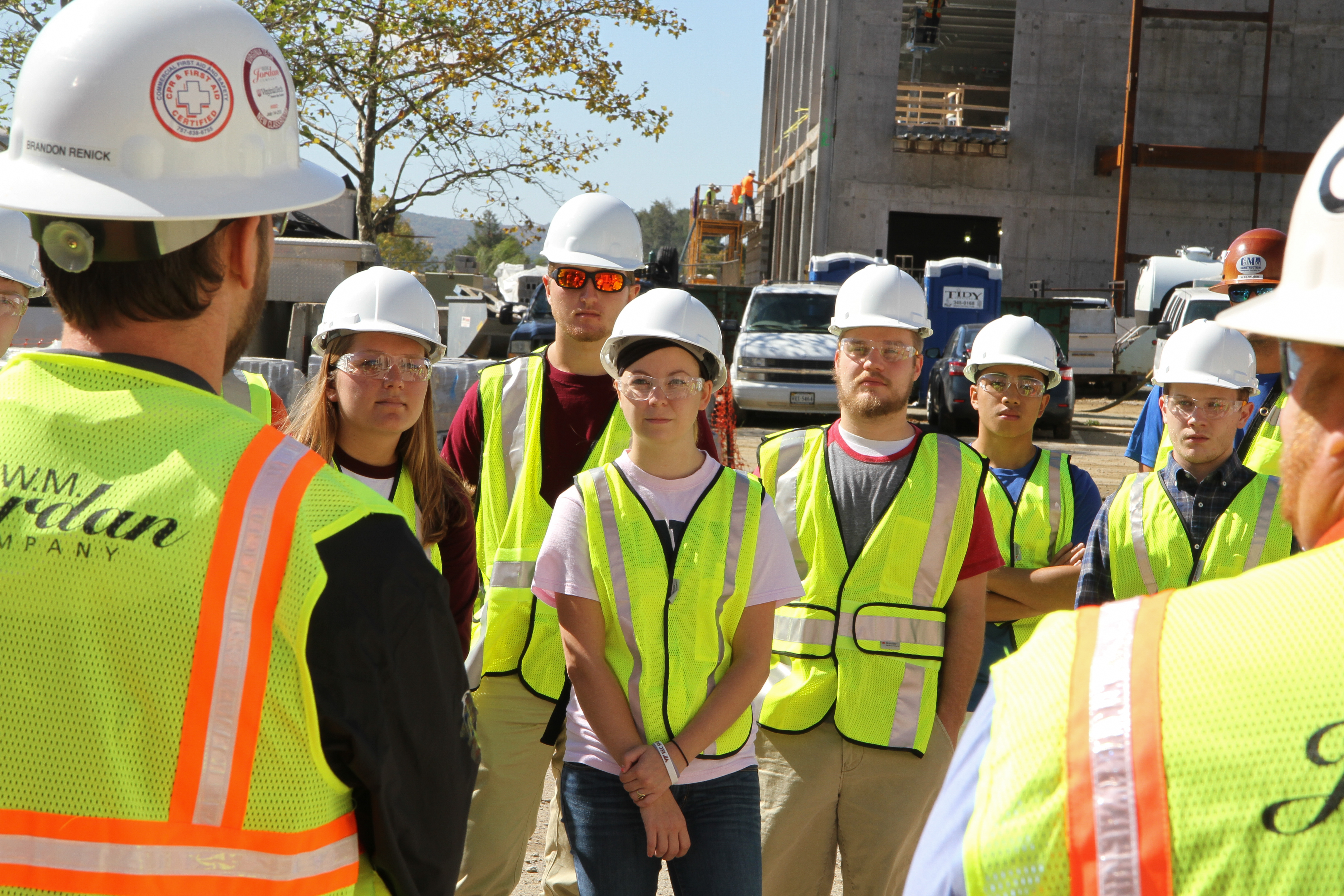Brendon Renick Assistant Project Manager with W.M. Jordan, leads students on a tour of a  construction site.