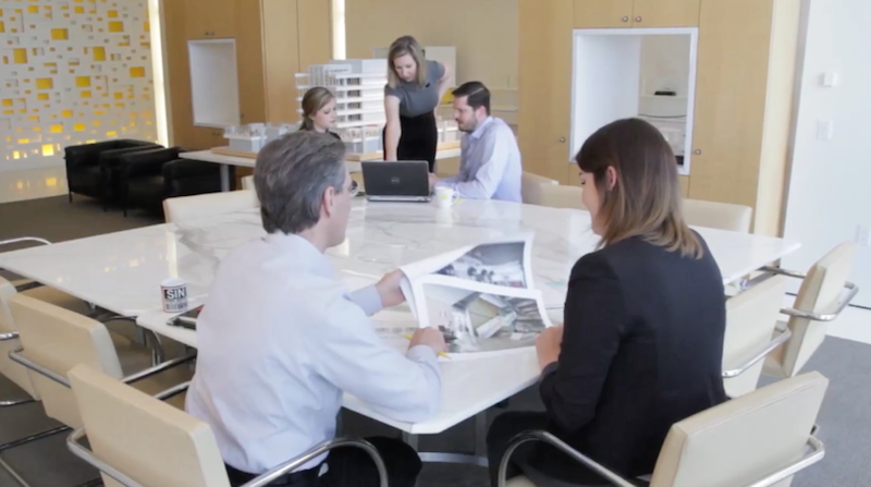 Five people work together in a PDR office meeting space