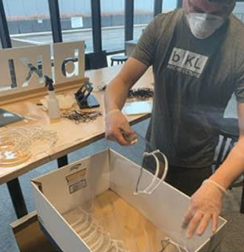 bKL staff pack face shields for delivery to Chicago healthcare workers