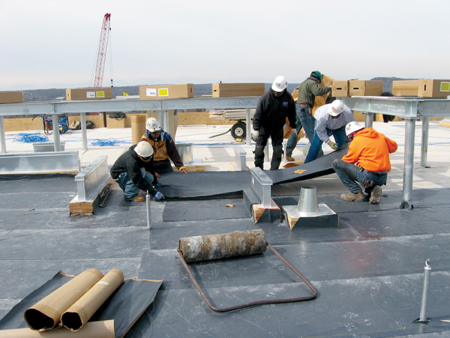Building owners must plan ahead for roof replacement to avoid emergency leak rem