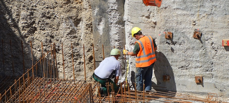 Two construction workers at a site