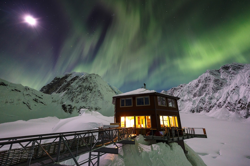 The Sheldon Chalet with the aurora borealis in the background