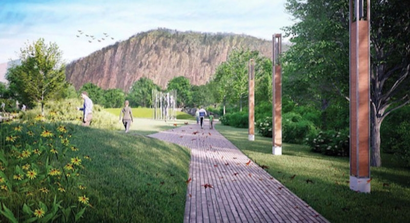 A park with light posts to the side of the path