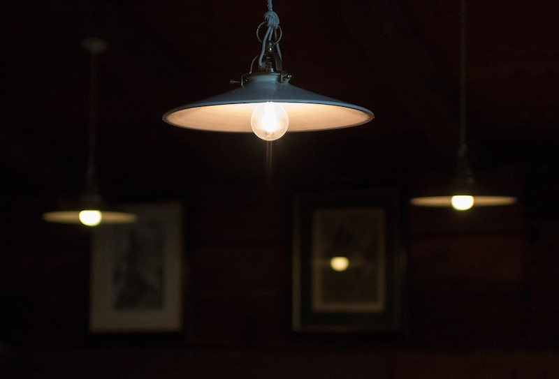 Lights hang from the ceiling in a building