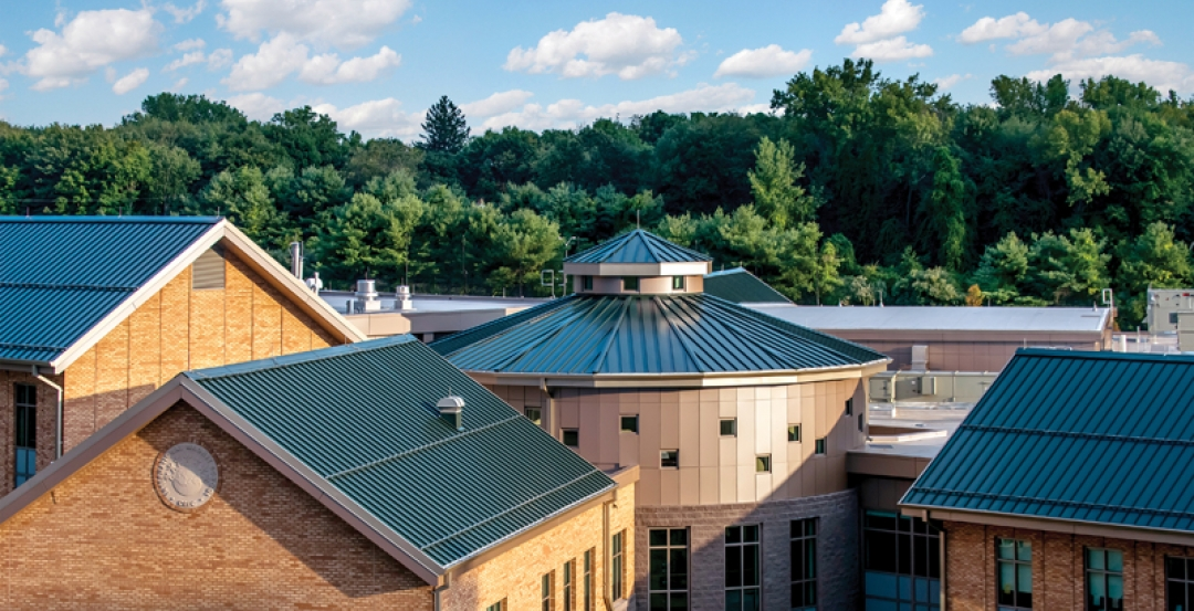 New school blends with local architecture using Petersen metal roof