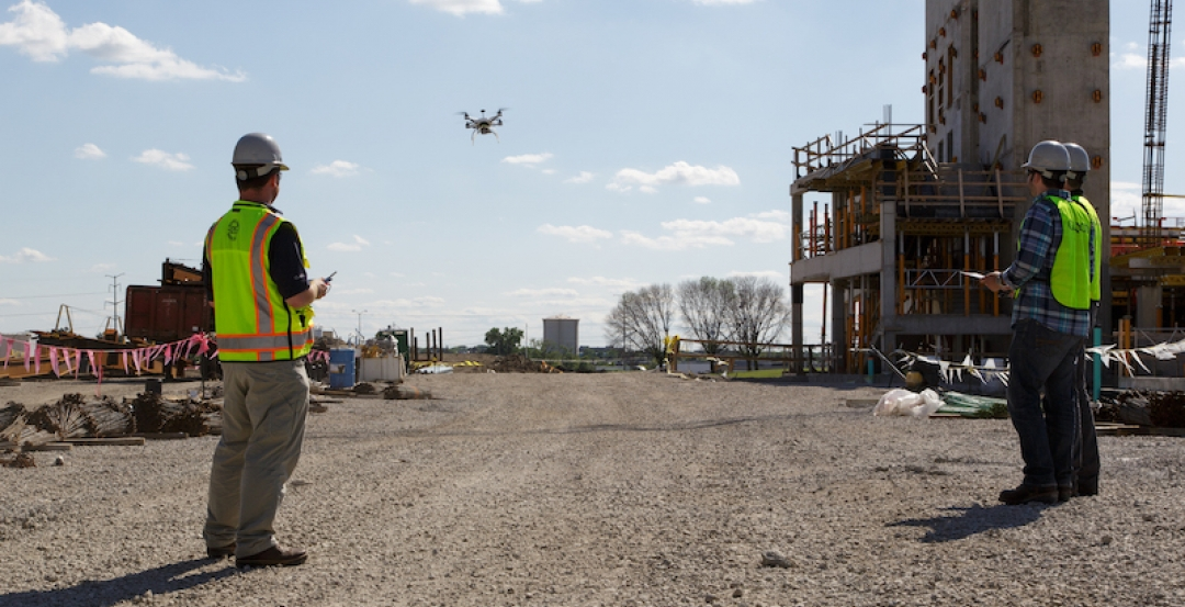 Contractors flying drone at a site