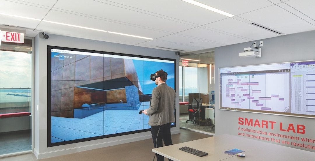 A Suffolk Construction team member explores one of the firm's projects using a CAVE virtual reality setup