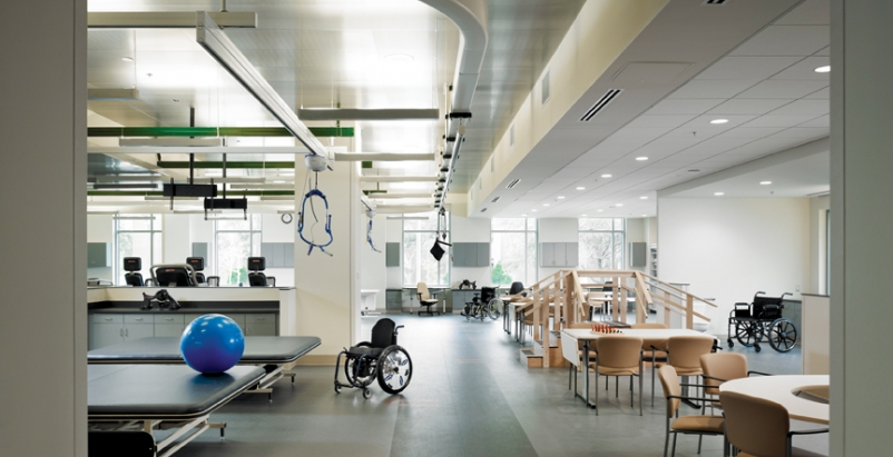 Metal tiles were used in the physical therapy gymnasium to give the space a more