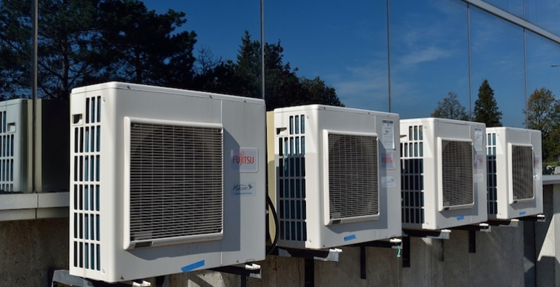 Four air conditioners on a roof