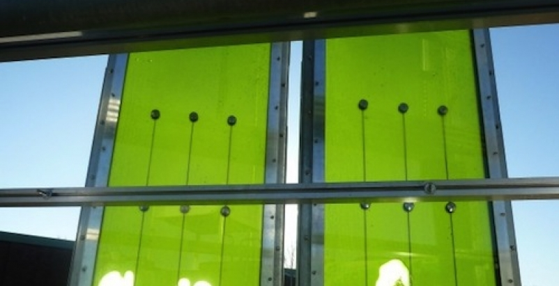 "Algae ""farms"" sandwiched between glass faade panels."
