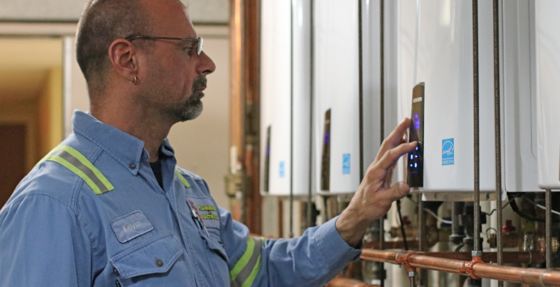 Contractor checks tankless water heaters in PA