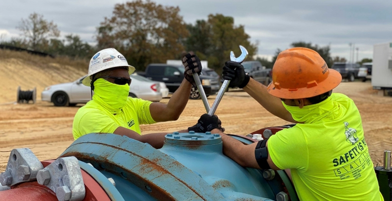 Garney Construction workers wearing Kenzen heat stress devices on their arms