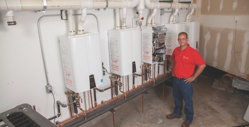Jason Richards, A+ Plumbing Heating and Cooling, with Navien NPE-240A tankless water heaters