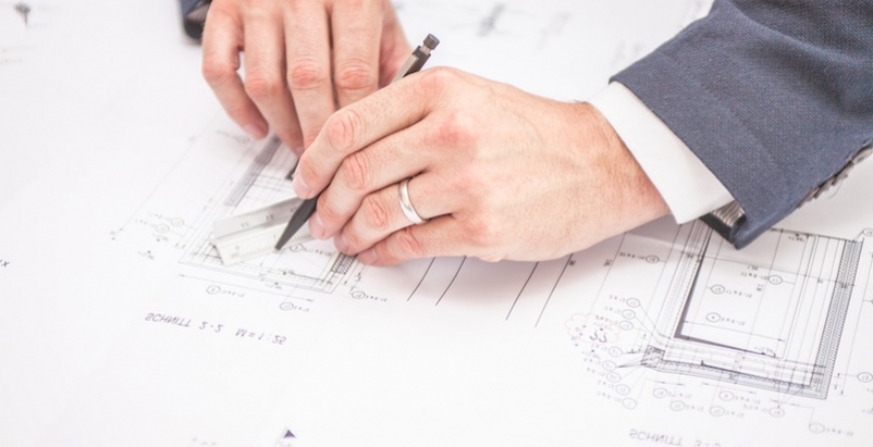 A man working on some blueprints