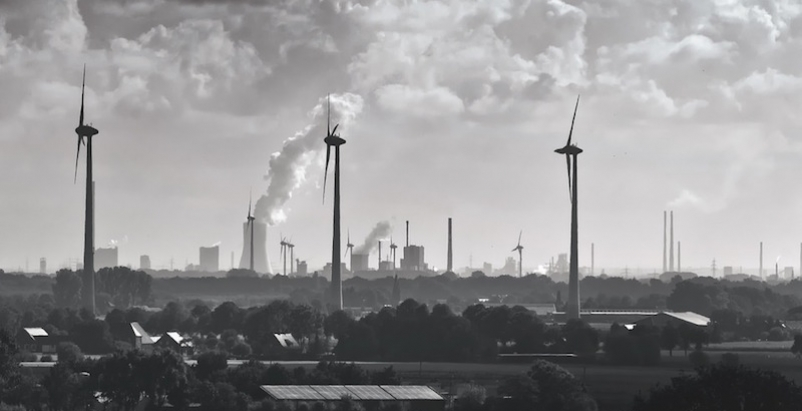 Wind turbines and smokestacks