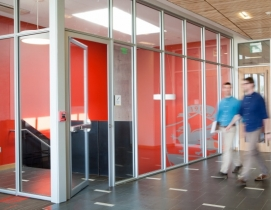 Transparent fire-rated entry evokes openness at Johnson & Wales University. Phot