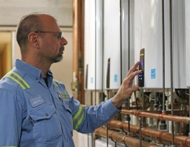Navien tankless water heaters being checked by plumbing contractor