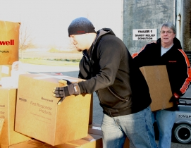 Honeywell employees offloading truck of donated first responder supplies in resp
