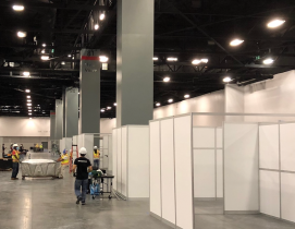 Isolation pods being installed at Miami Beach convention center by Robins & Morton.