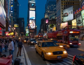 A Cab and people in Times Square