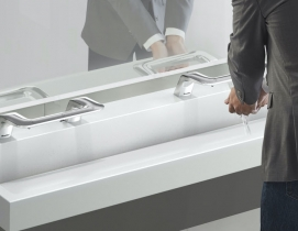Man washing hands at washbar