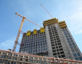 Building under construction and by cranes