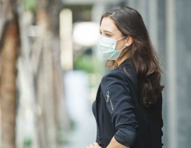 Woman wearing a mask outside