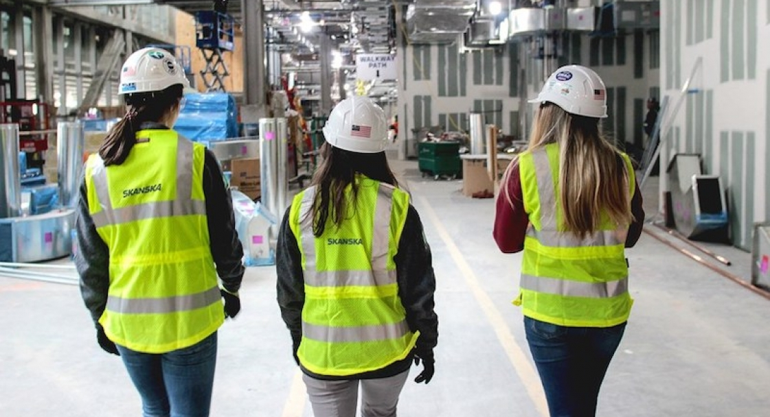3 women wearing Skanska's new line of PPE